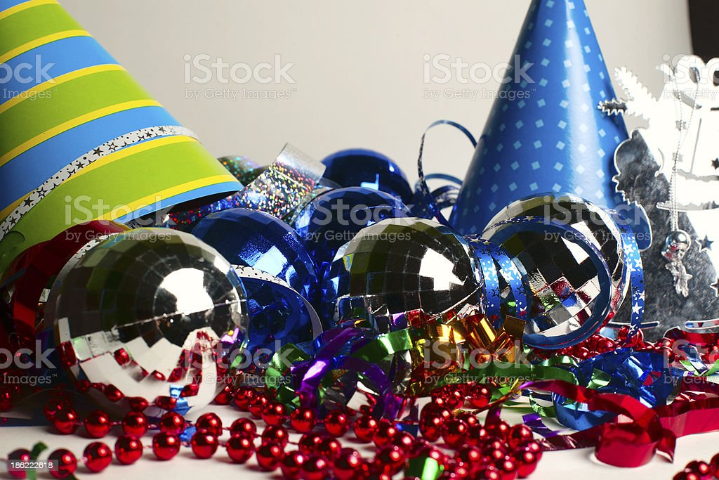 Party hats, beads, ribbons and ornaments stock photo