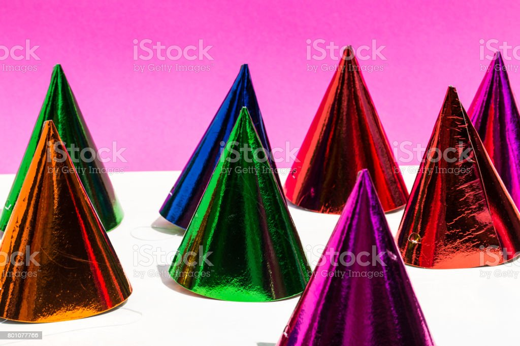 Party hats, birthday, carnival, party,pink background stock photo