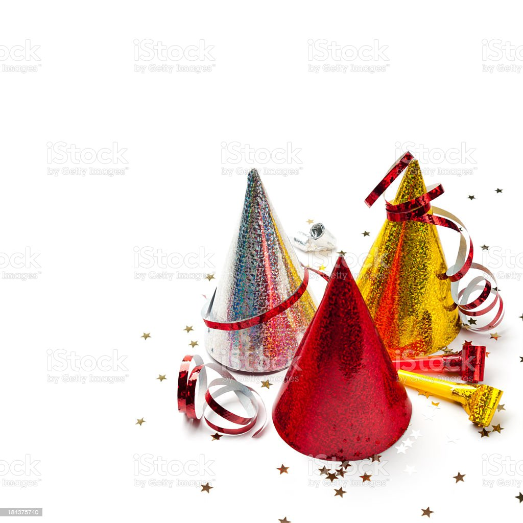 Party hats, whistles, streamers, confetti, isolated on white, studio shot stock photo