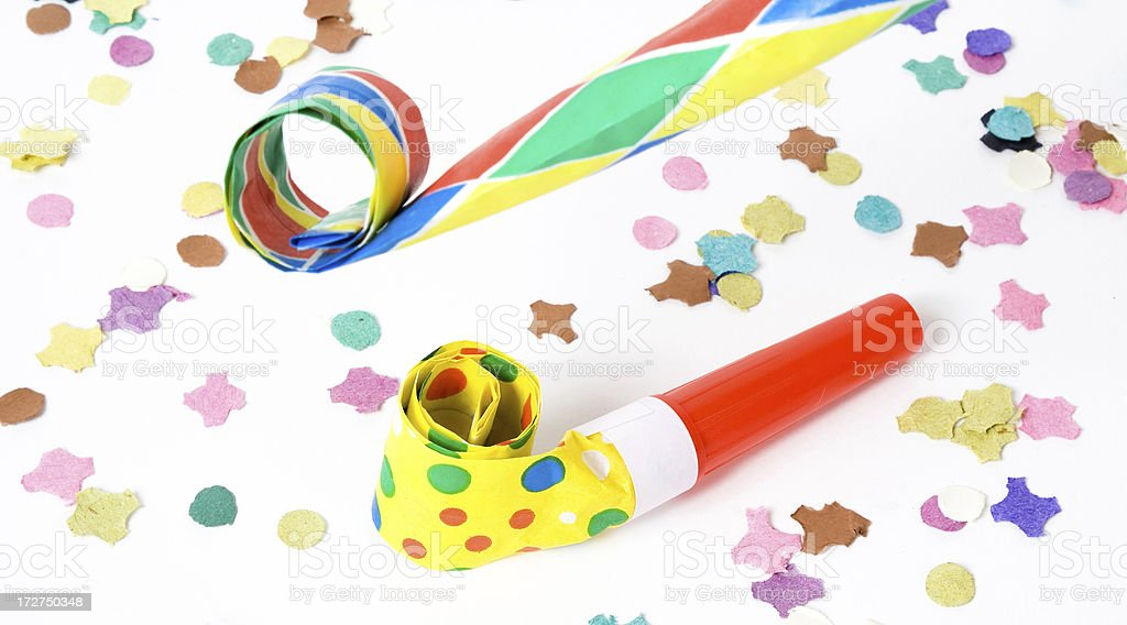 Party horn blower and confetti stock photo