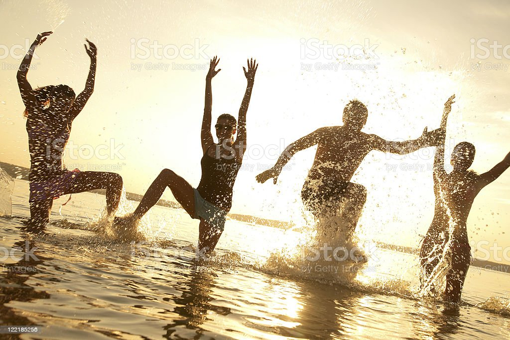 Party on the beach and in the water royalty-free stock photo