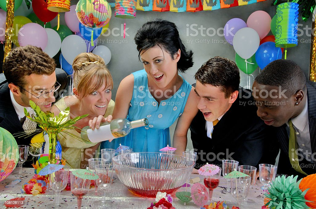 Party People Adding Alcohol to Punch stock photo