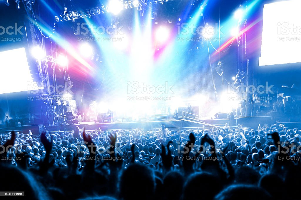 Party people at a frenetic pop concert stock photo