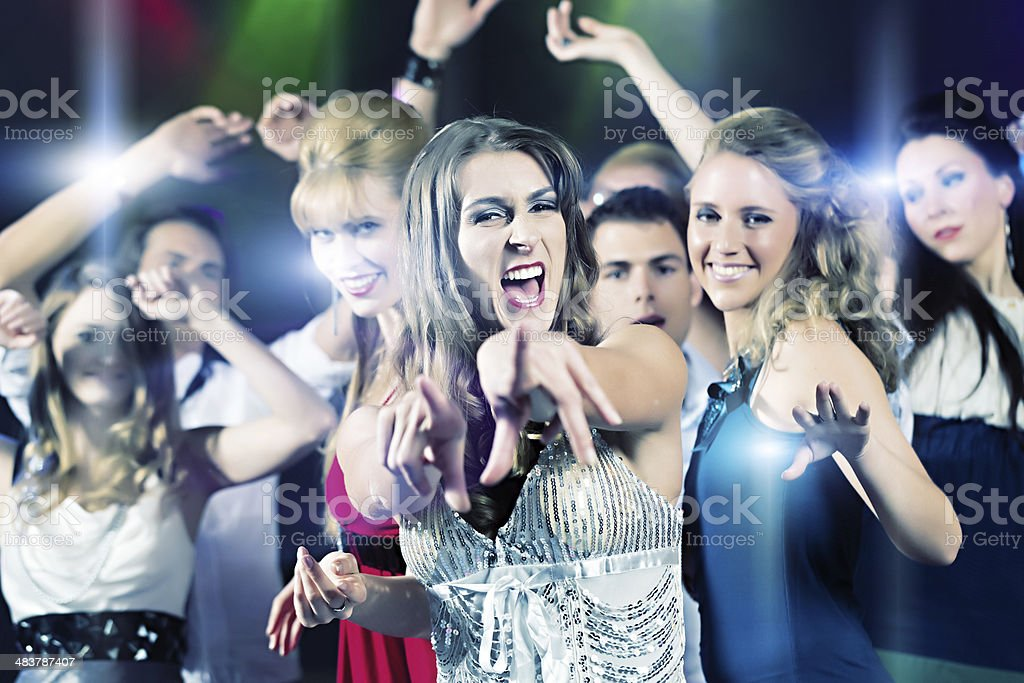 party people dancing in disco club stock photo