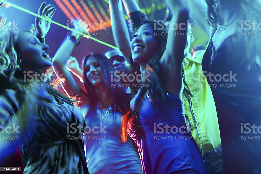 Party people dancing in disco or club royalty-free stock photo