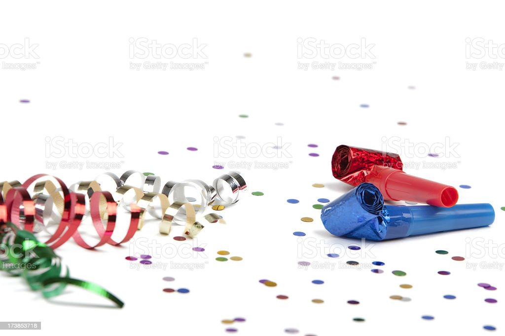Party ribbon confetti and horn blower on white background stock photo