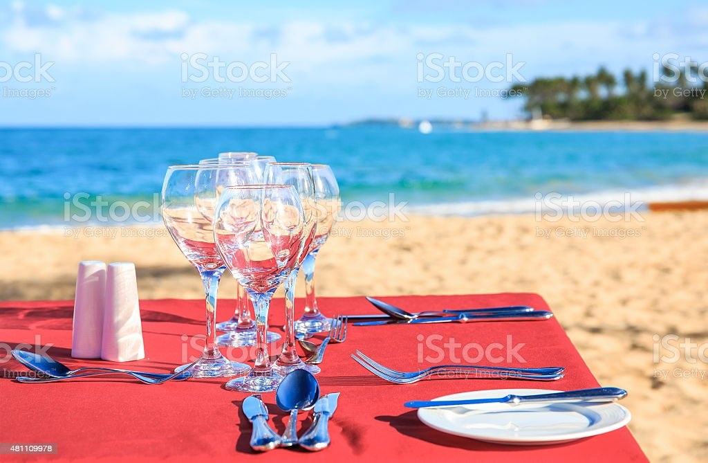 Party table on the beach stock photo