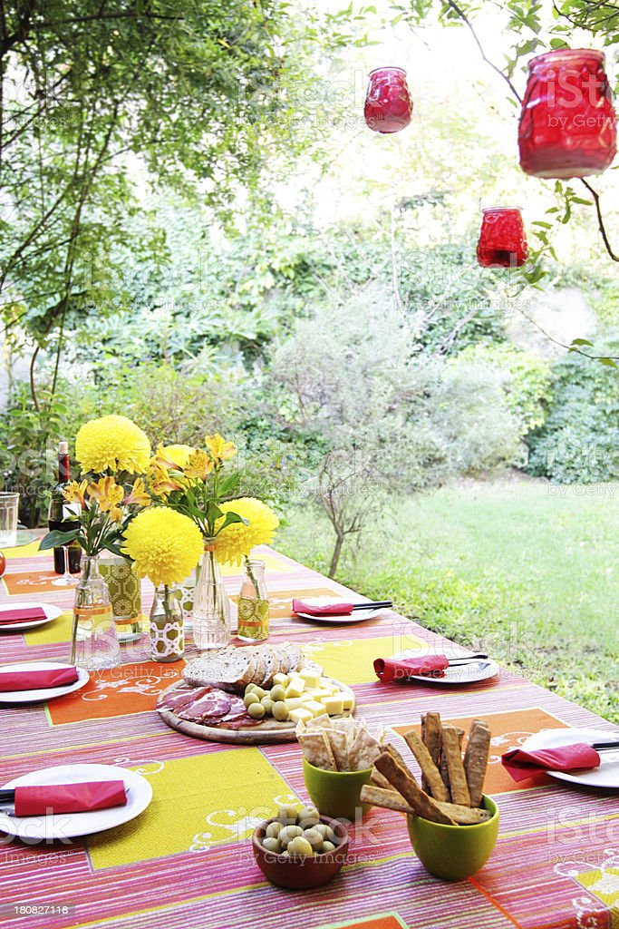 Party table with buffet, flowers and deco at garden stock photo