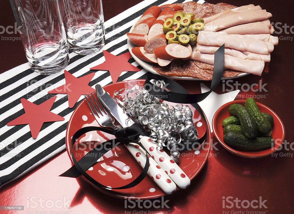 Party table with food in red, black and white. royalty-free stock photo