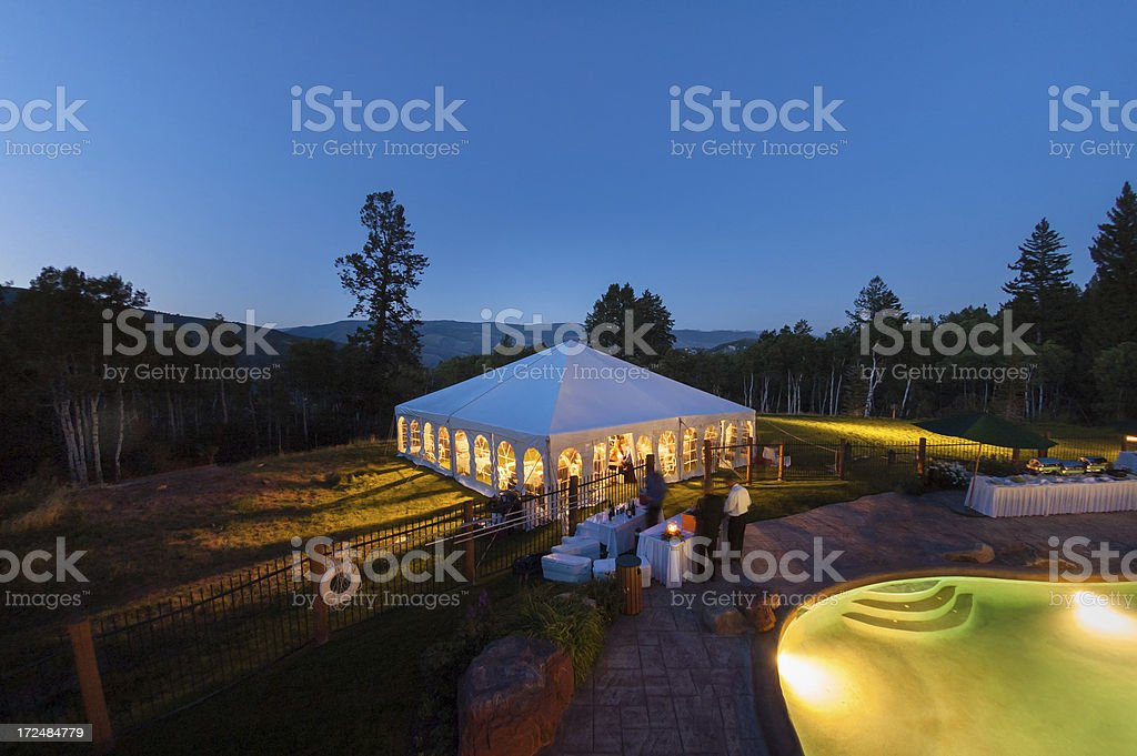 Party Tent Glowing at Dusk stock photo