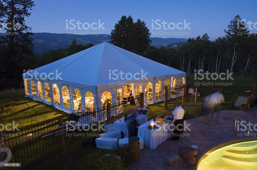 Party Tent Glowing Warm at Dusk with Cool Blue Light royalty-free stock photo