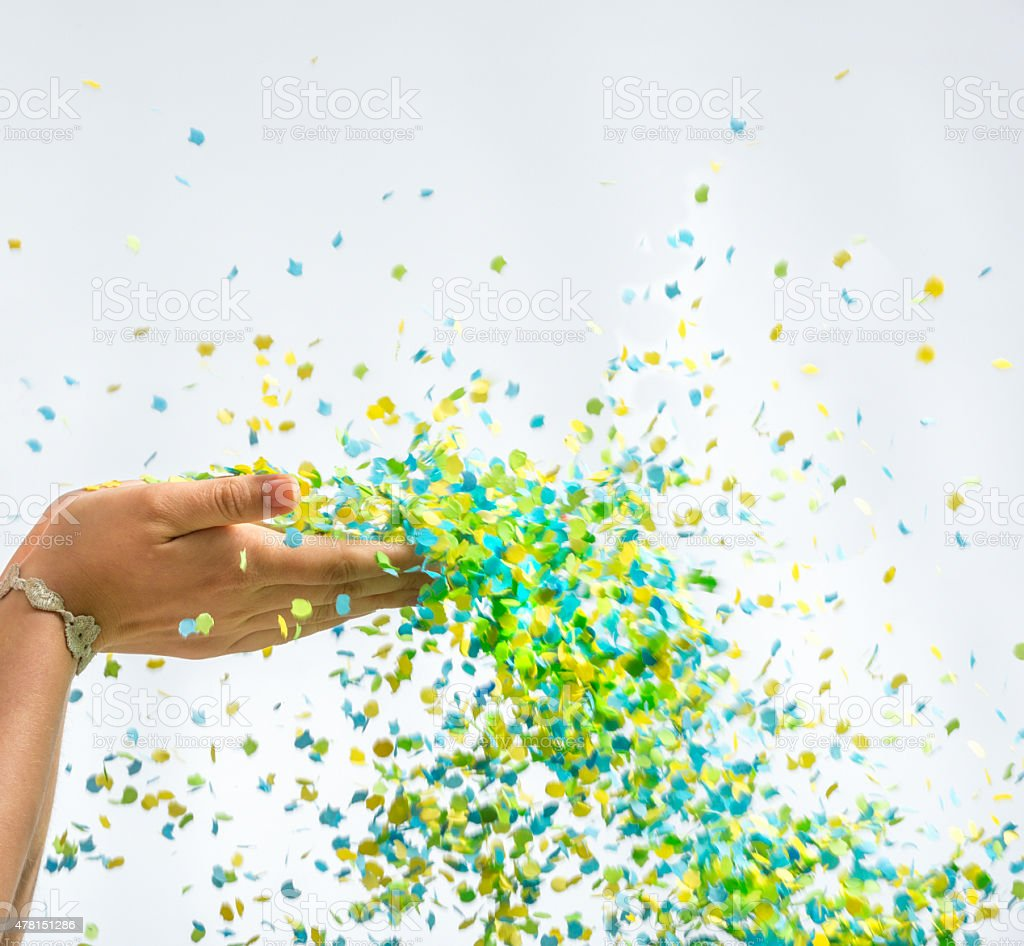 Party Time, two hands and confetti shower stock photo