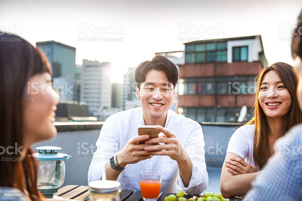Party with friend in a downtown rooftop stock photo
