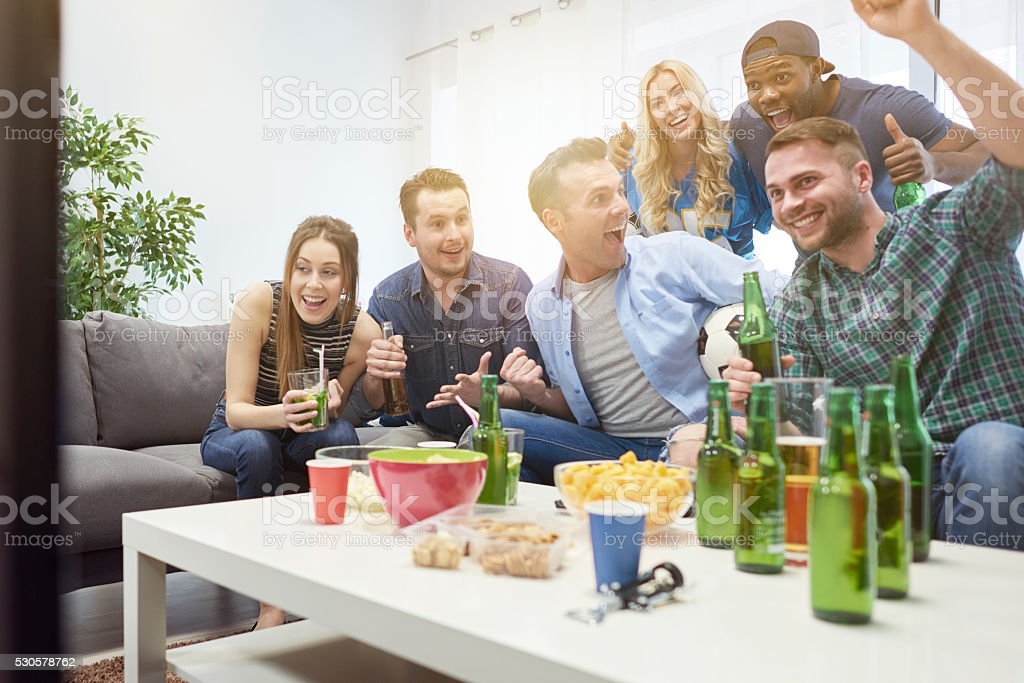 Party with friends during the match stock photo