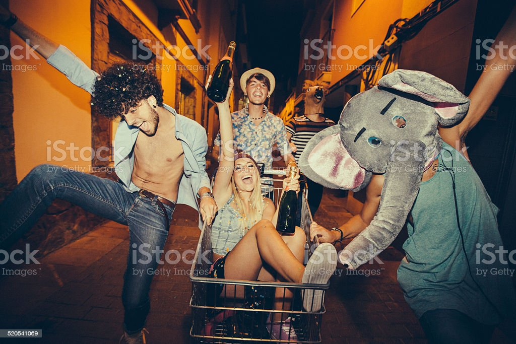 Partying Teenagers Being Silly In Street stock photo