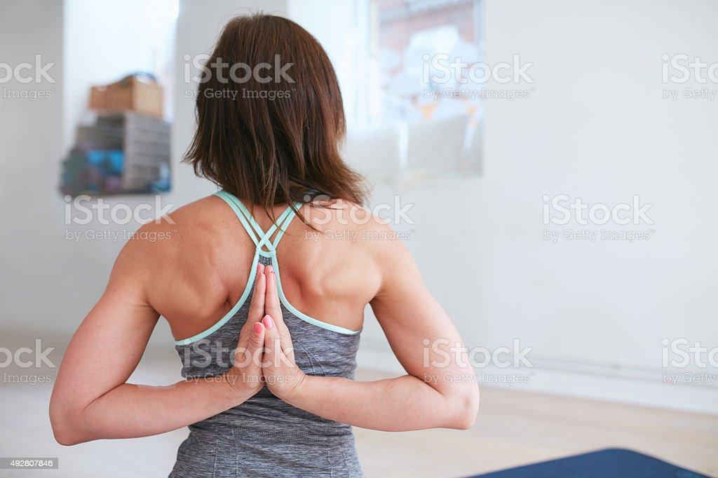 Pashchima Namaskarasana performed by a fitness female stock photo