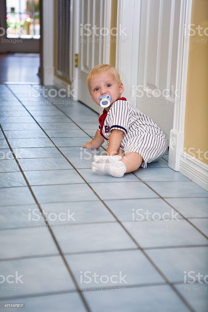 pasi toddler on tile floor royalty-free stock photo