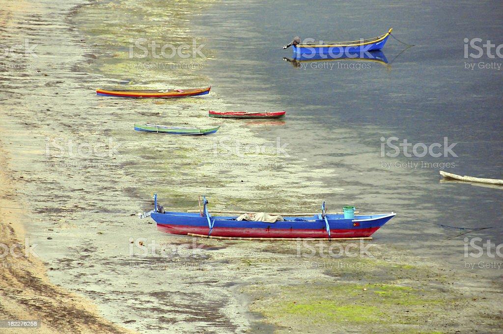 Pasir Putih beach, East Timor: fishing boats stock photo