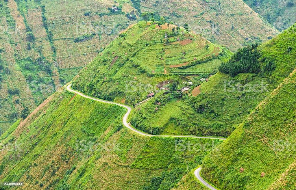 Pass road hugs mountain plateau stock photo