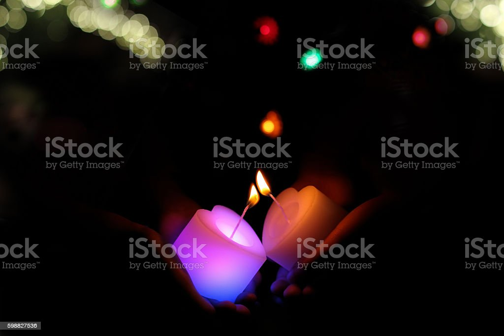 I pass the flame of the candle. stock photo