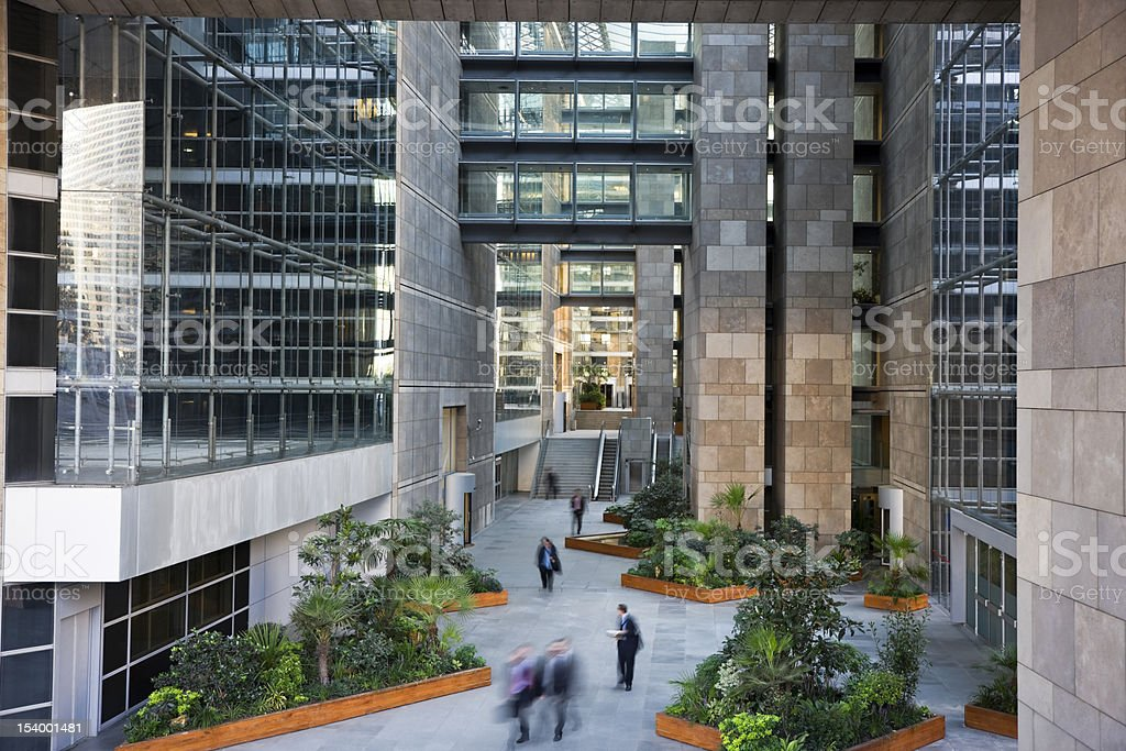 Passage in a Business Center With Walking Business People stock photo