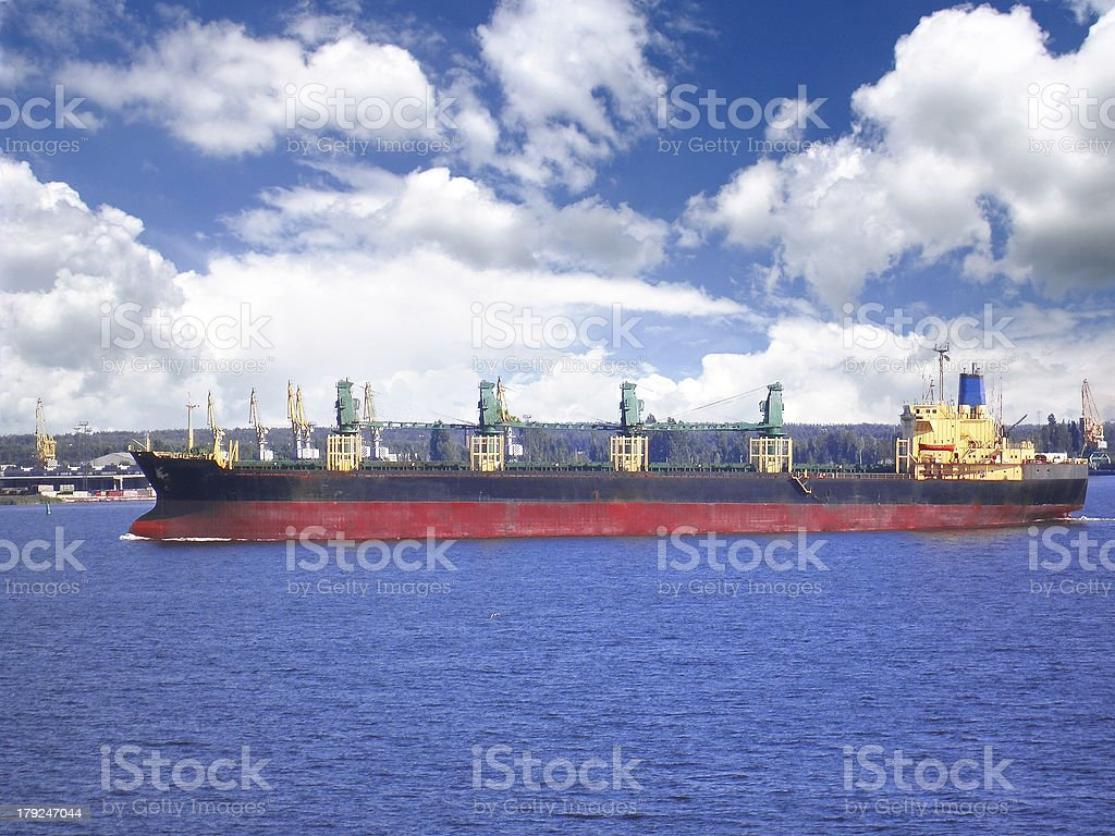Passage of the cargo ship on a waterway royalty-free stock photo