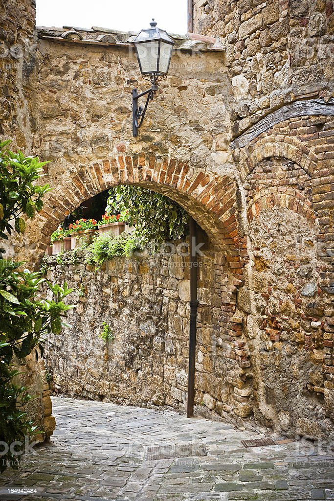Passage with Arch in an Ancient Tuscan Village, Italy royalty-free stock photo