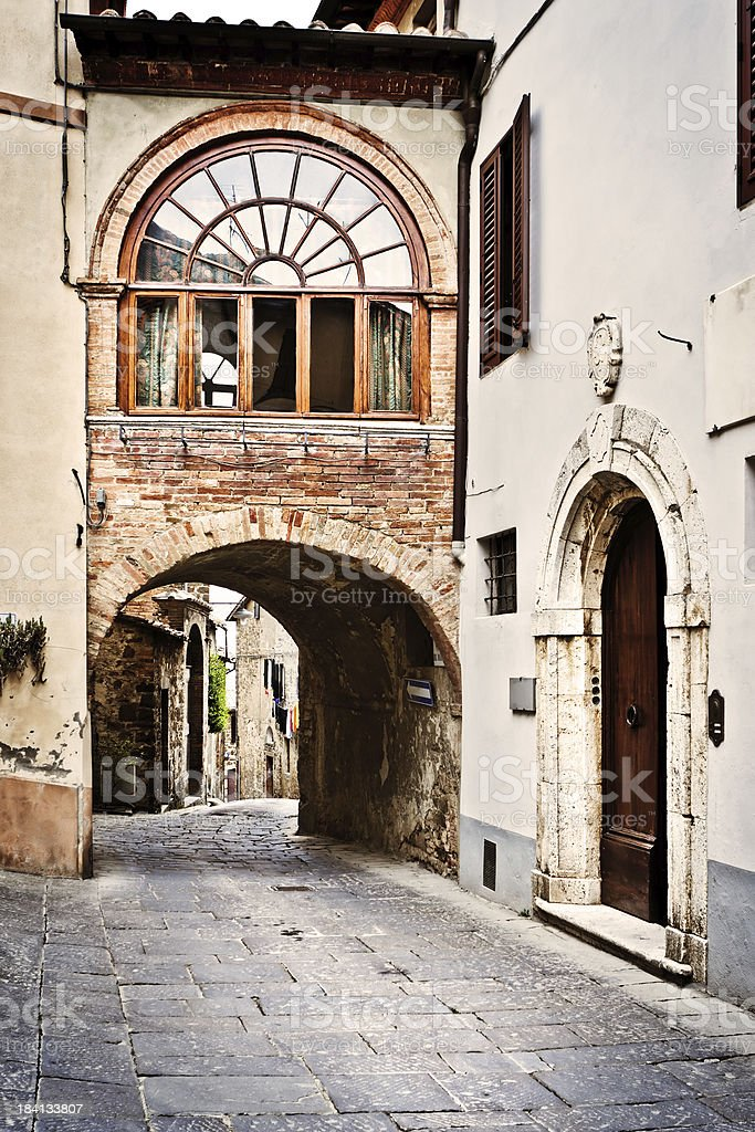Passage with Arch in Ancient Village of Montalcino, Val d'Orcia royalty-free stock photo
