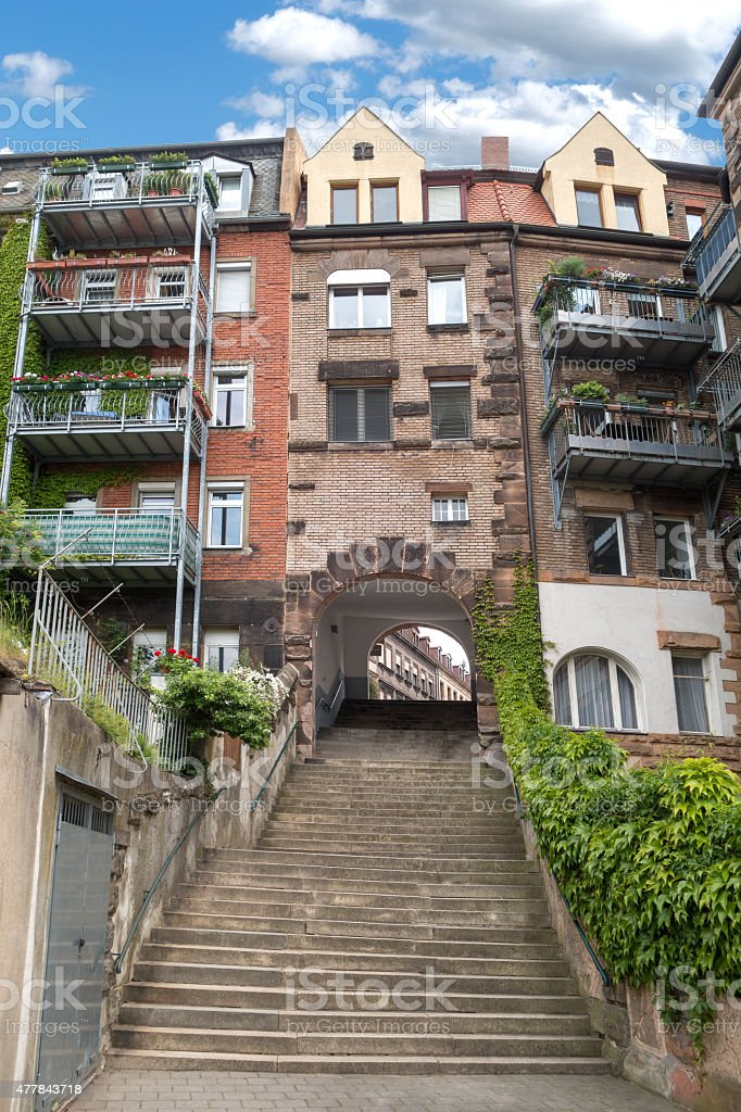 Passage with stairs under a townhouse stock photo