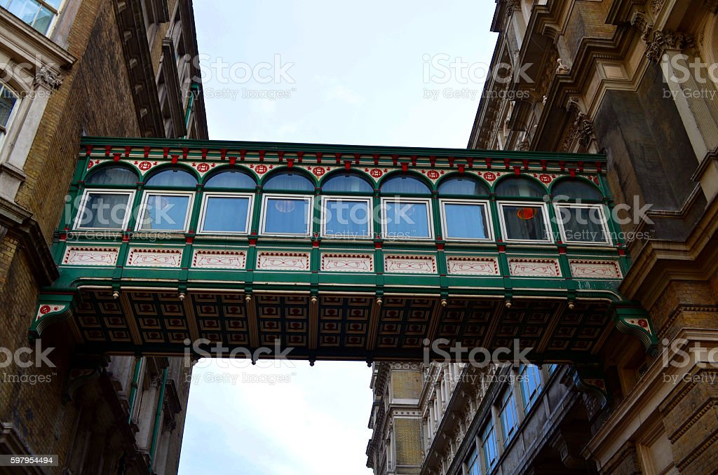 passageway connecting two british buildings with arch windows uk london stock photo