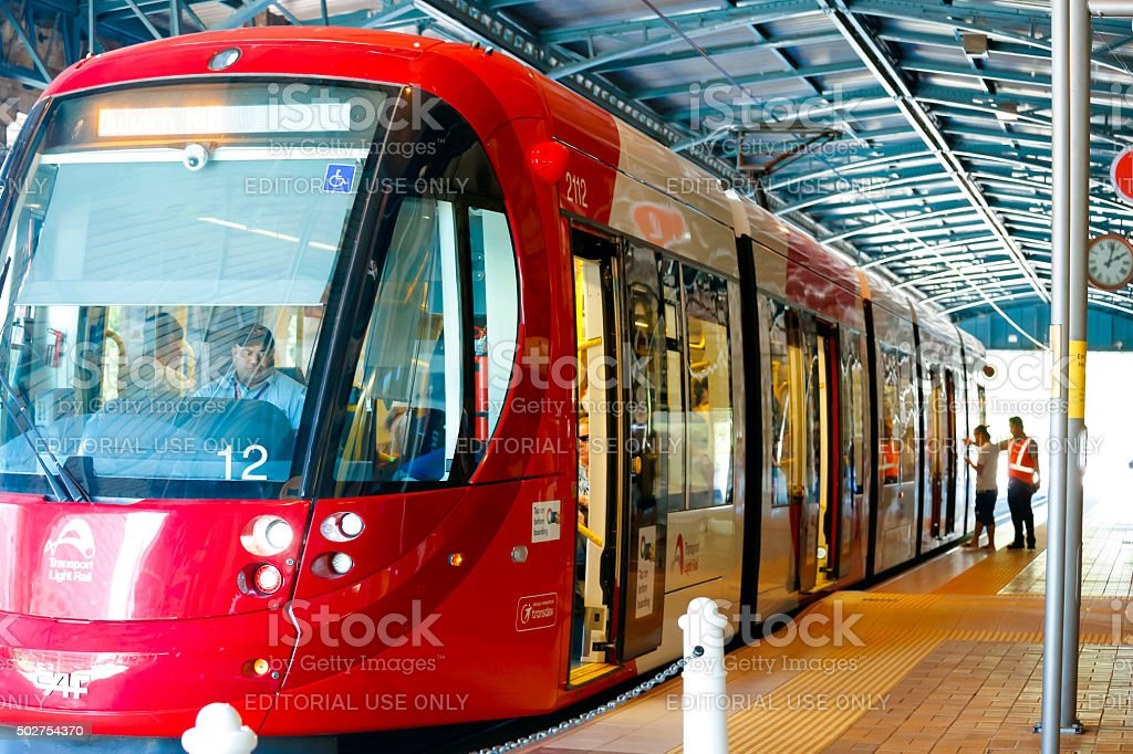 Passangers boarding light rail at the Central station in Sydney stock photo