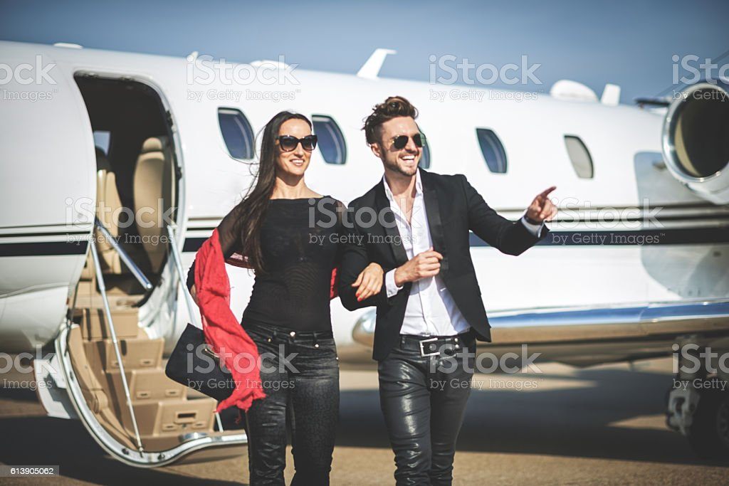 Passangers leaving private jet airplane stock photo