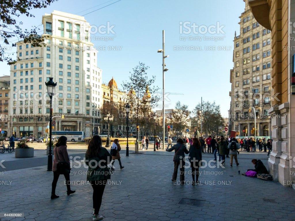 passeig de gracia gran via barcelona poor walking stock photo