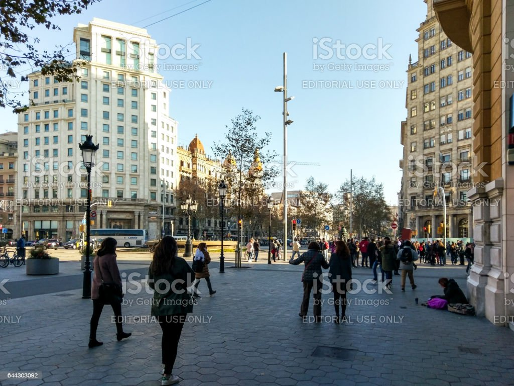 passeig de gracia gran via barcelona poor walking stock photo
