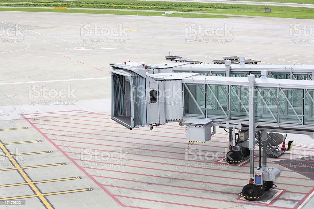 passenger air bridge walkway in airport for planes stock photo