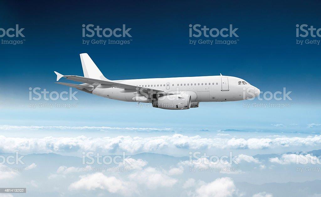 Passenger airliner flight in the blue sky stock photo
