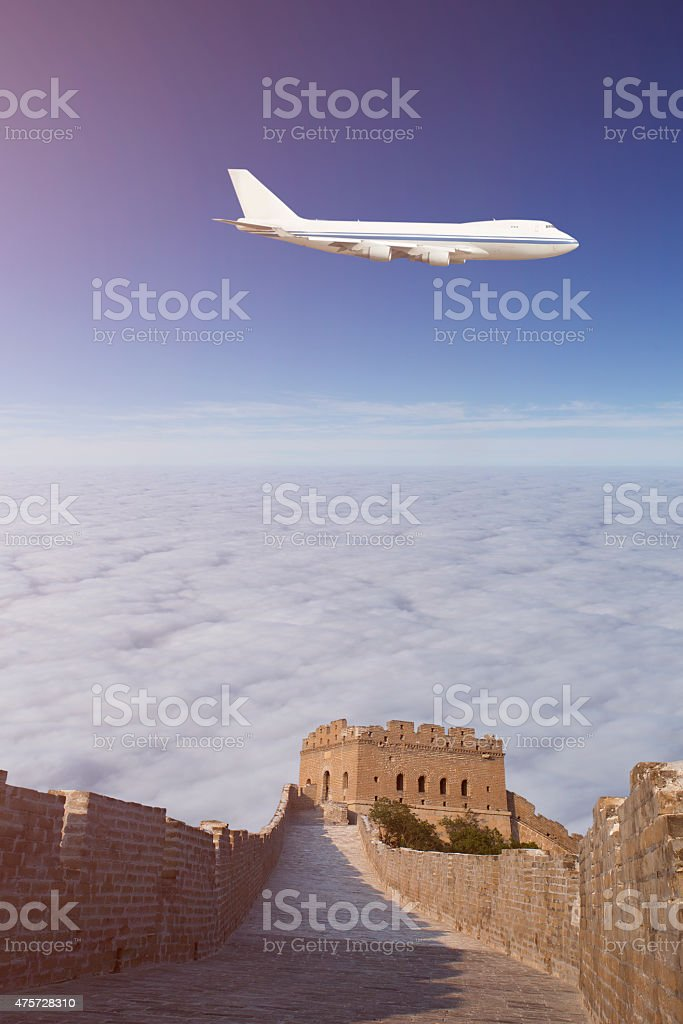 Passenger Airliner flying over Greatwall stock photo