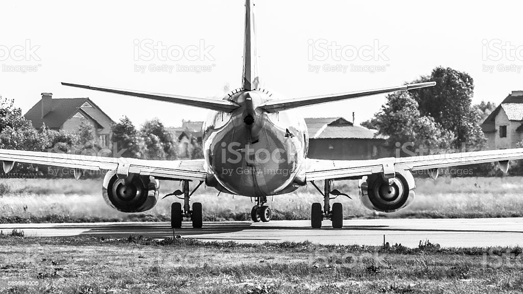 Passenger Airliner in Airport stock photo