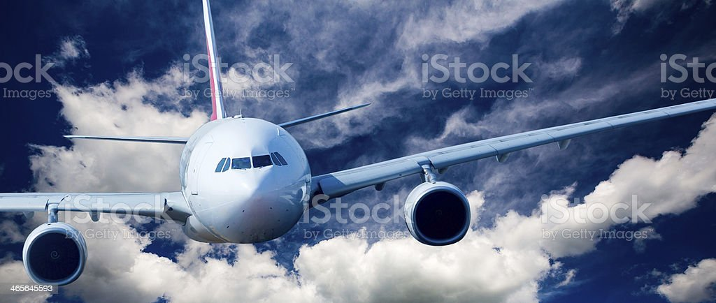 Passenger Airliner in the sky royalty-free stock photo