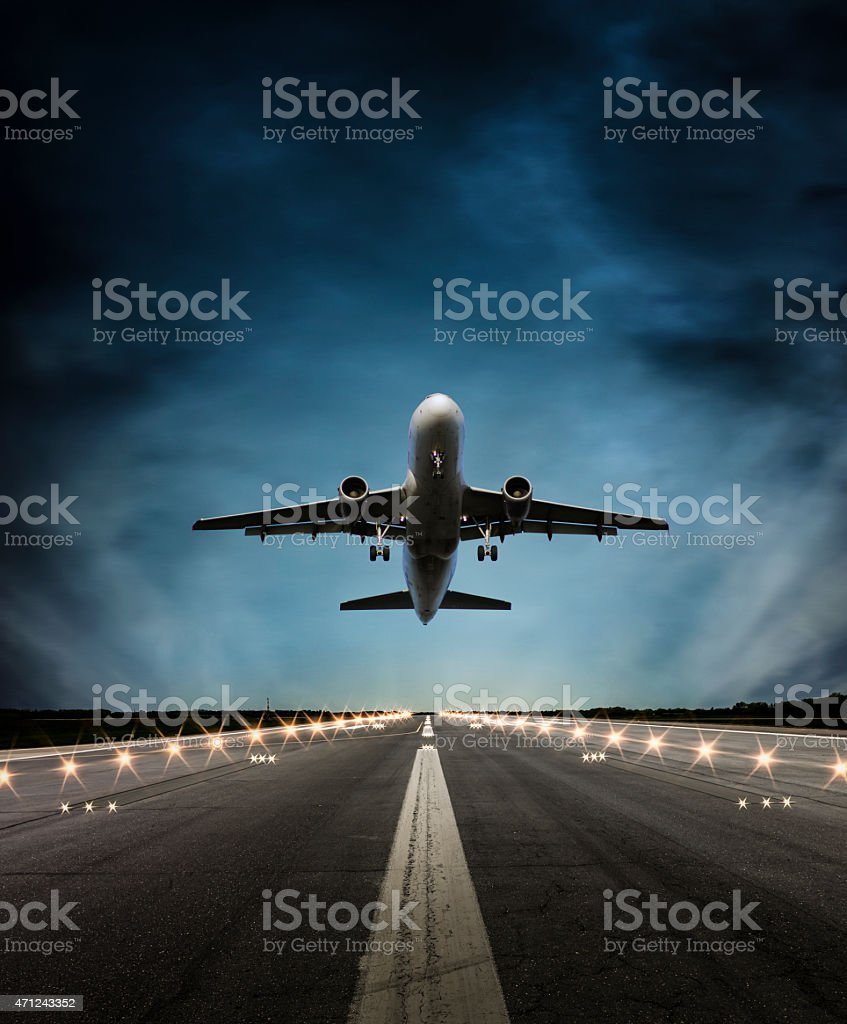 Passenger airplane at dusk stock photo