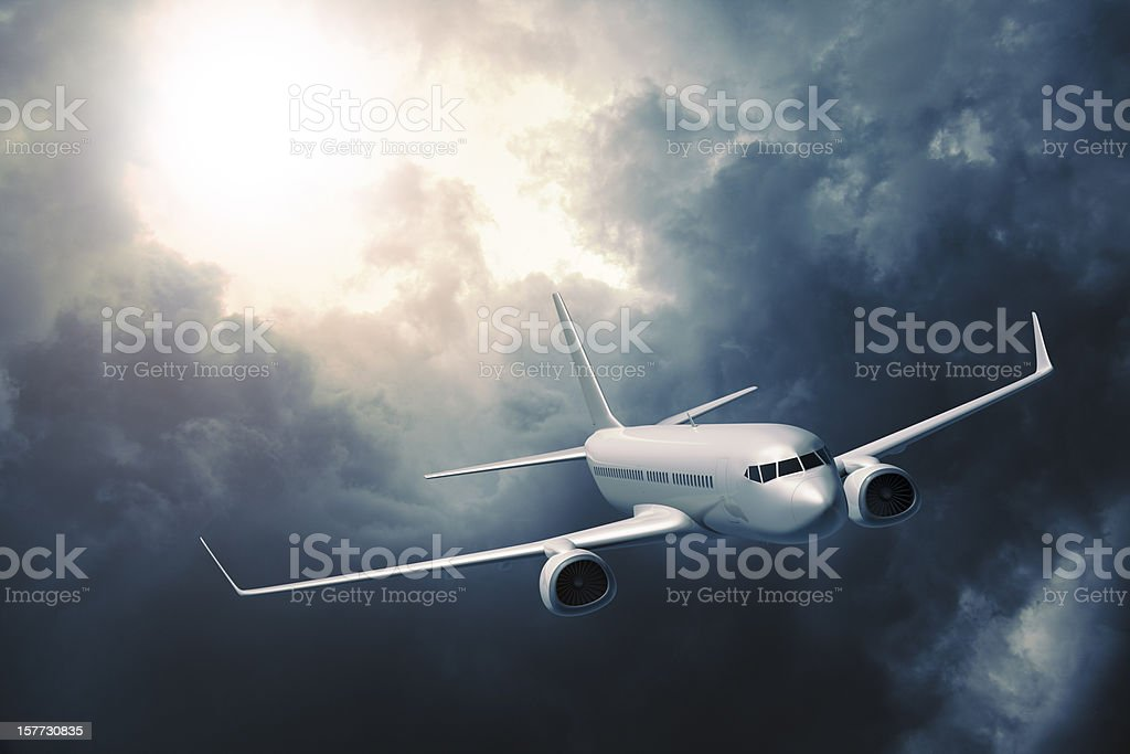 Passenger airplane flying in storm stock photo