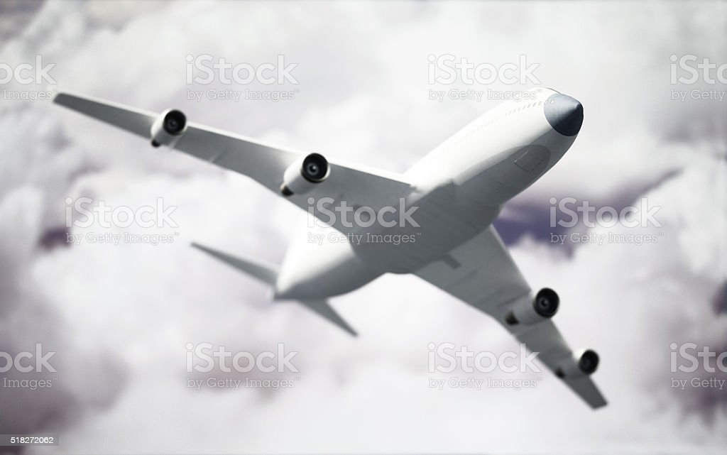 Passenger airplane flying in the sky stock photo