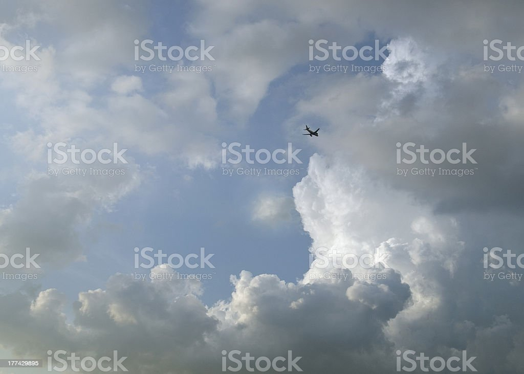 passenger airplane in clouds royalty-free stock photo