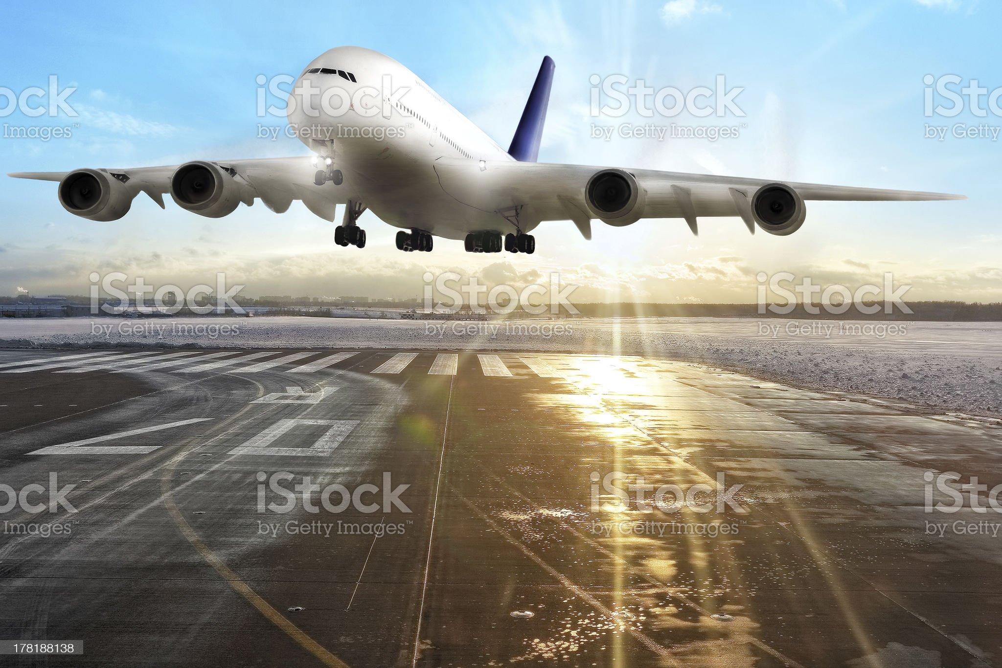 Passenger airplane landing on runway in airport royalty-free stock photo