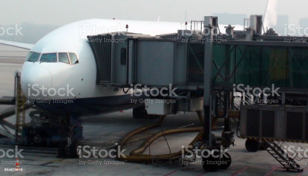 Passenger Airplane Parked At Airport stock photo