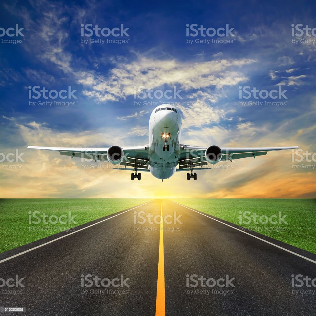 Passenger airplane take off from runways against beautiful  sky stock photo
