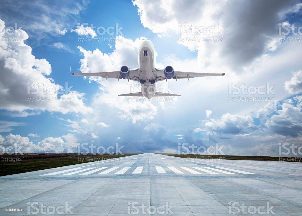 Passenger airplane taking off stock photo