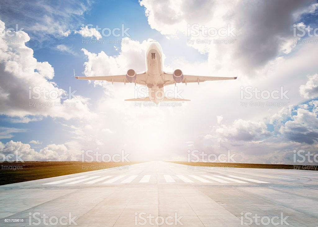 Passenger airplane taking off stock photo