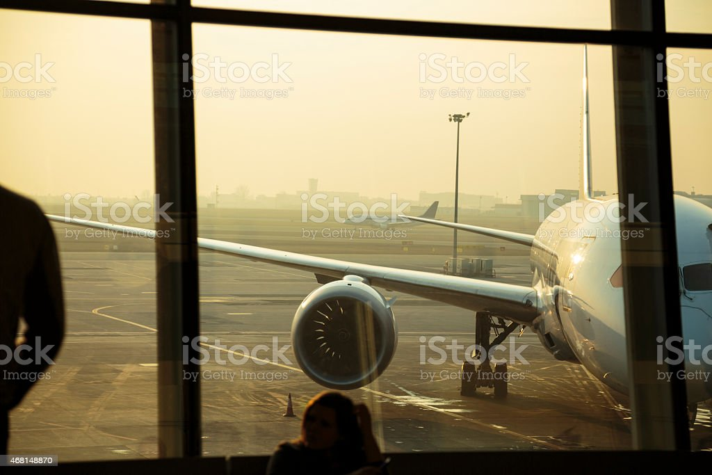 Passenger airplanes seen through window of the airport in Warsaw stock photo