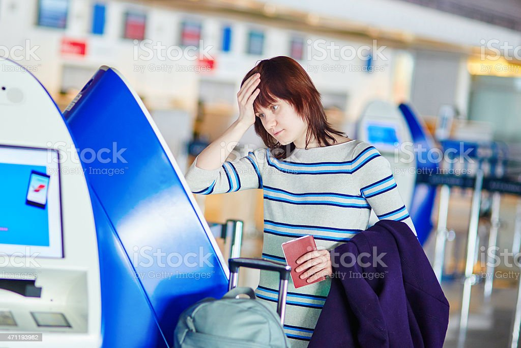 Passenger at the airport, doing self check-in stock photo